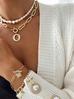 Bransoletka złota perłowa z kryształkami i krzyżykami  BRG0120
