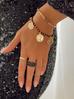Bransoletka złota z kryształkami i monetkami BRG0138