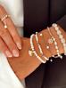Pierścionek elastyczny z perełkami  PLB0006
