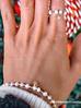 Pierścionek elastyczny z perełkami i złotą gwiazdką z cyrkoniami PPE0008