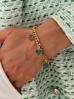 Bransoletka złota z charmsami BRG0190