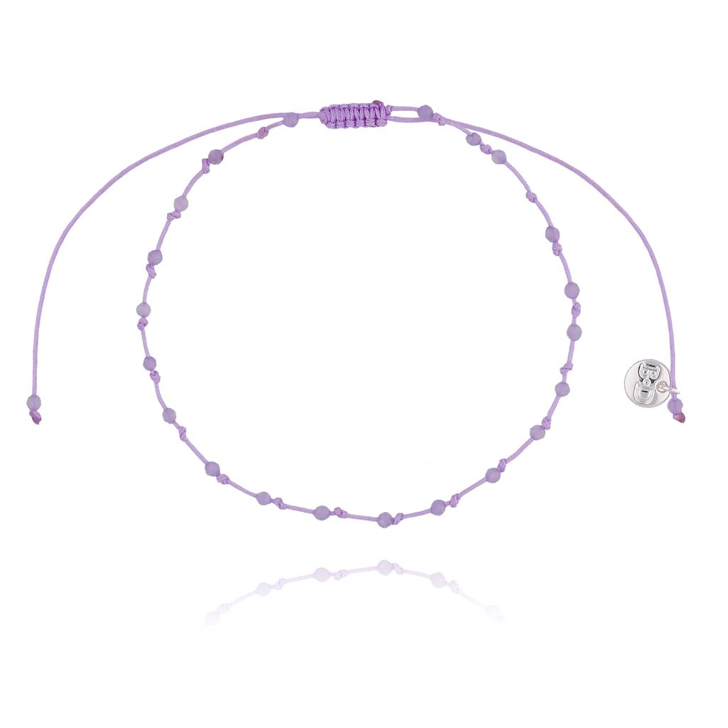 Bransoletka ze sznurkiem z supełkami fioletowa pastelowa BSC0775