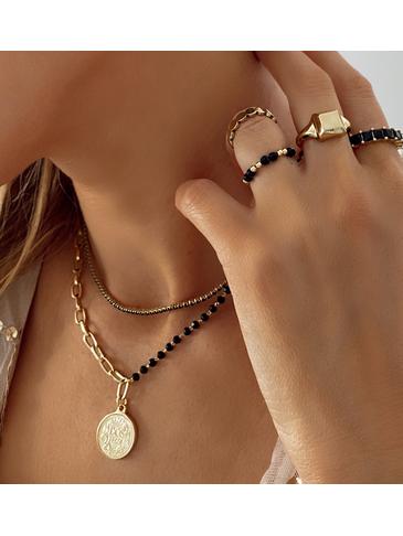 Naszyjnik z łańcuszkiem i z czarnymi kryształkami z monetą NRG0179