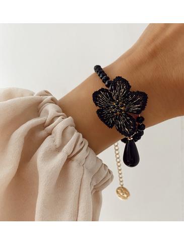 Bransoletka złota z czarnym kwiatem BLI0003